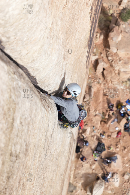 High angle view of female hiker climbing on mountain