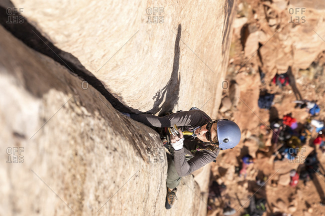 High angle view of male hiker climbing mountain