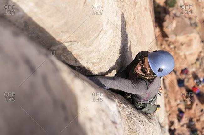High angle view of man climbing mountain