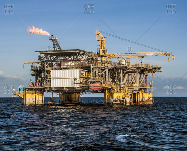 Oil production platform amidst sea
