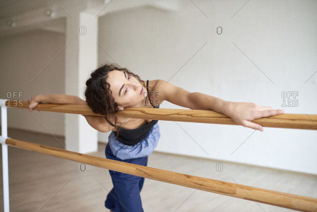 Woman dancing on barres at studio