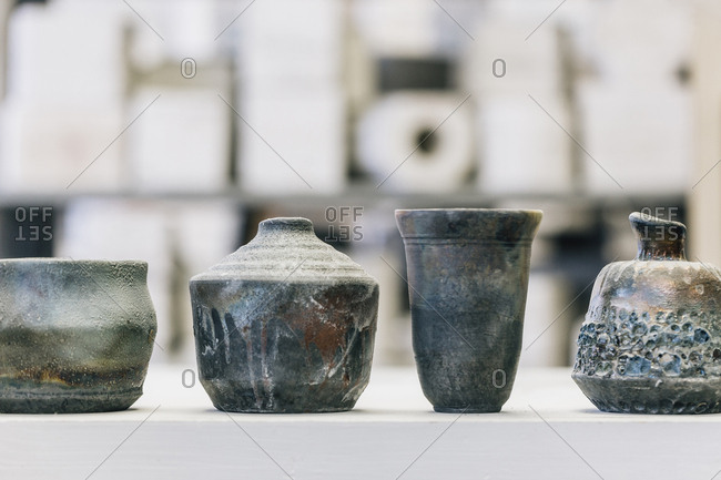 Close-up of earthenware on table at workshop