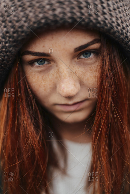 Close-up portrait of teenage girl wearing knit hat