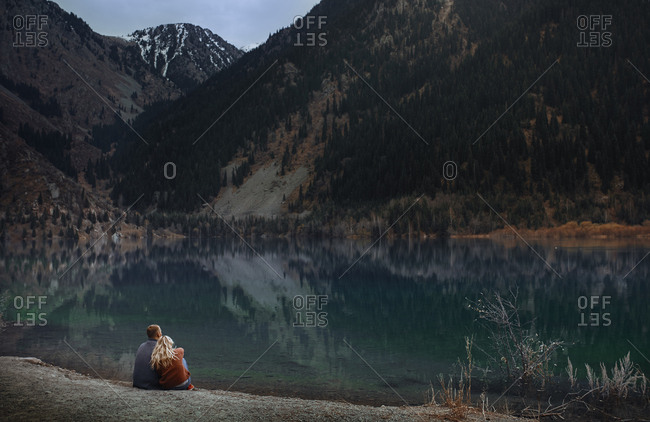 Couple relaxing at the mountain lake