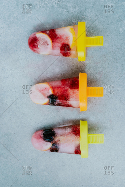 Three lemon raspberries and blackberries popsicles
