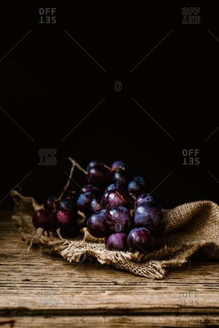 Fresh grapes on a wooden background
