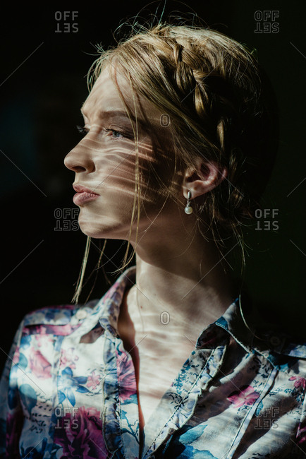 Portrait of blonde girl with hair braids looking romantic and sensual