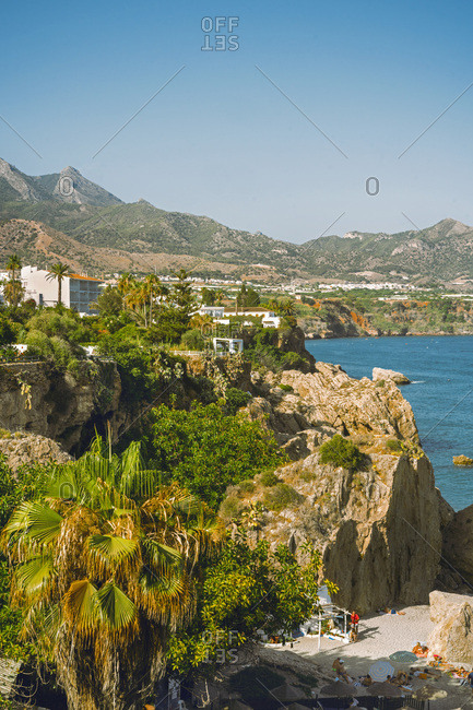 Nerja, Spain - 04 July 2017: View along the rugged coastline of the resort town