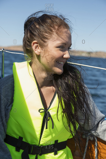 Woman wearing life jacket on boat