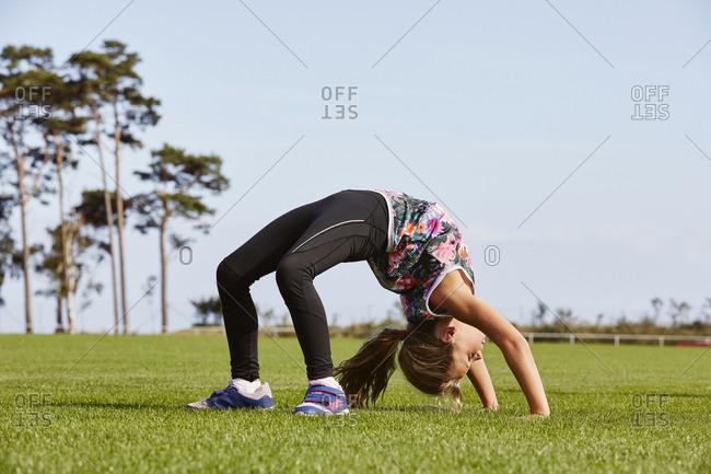 Girl doing bridge exercise