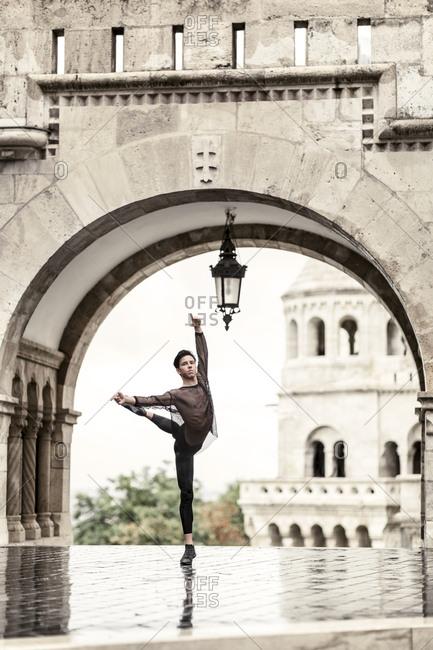 Ballet dancer by gate