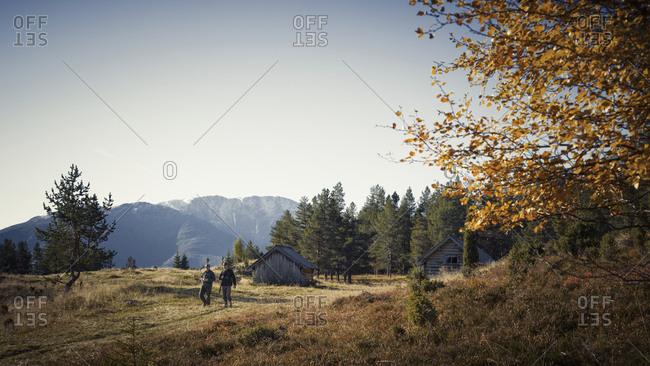 Hunters walking in mountain landscape