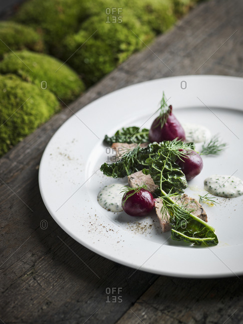 Appetizer with baby beetroots and herbs