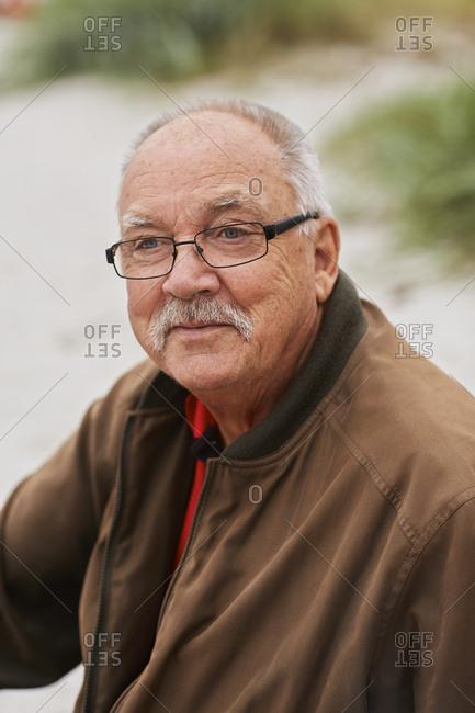 Portrait of senior man looking away