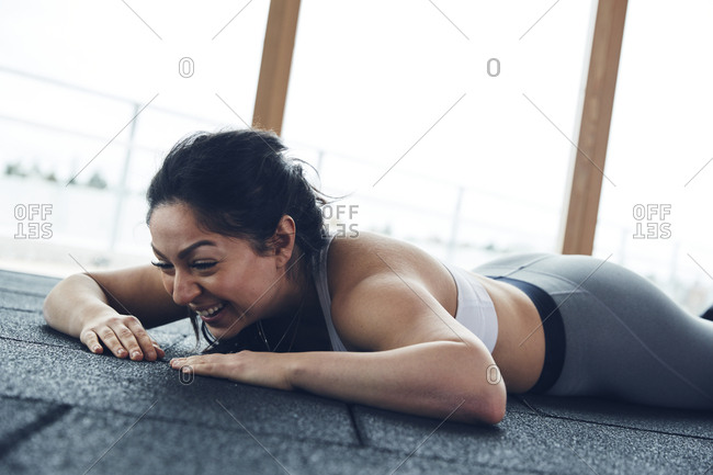 Woman lying down on floor
