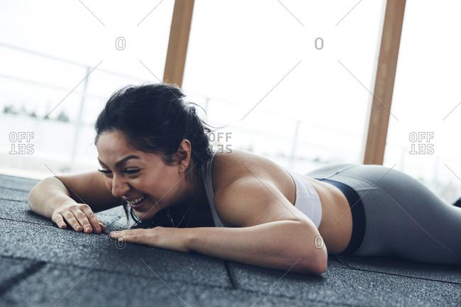 Woman lying down on floor