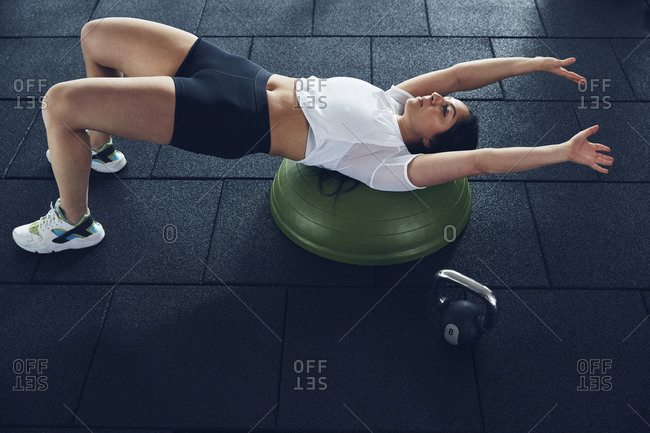 Woman exercising with bosu ball
