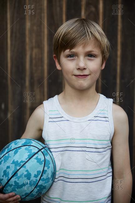 Portrait of boy holding ball