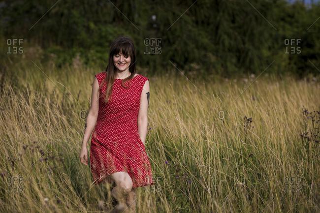 Beautiful woman walking on meadow
