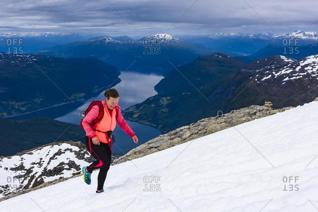 Woman hiking in snowy landscape