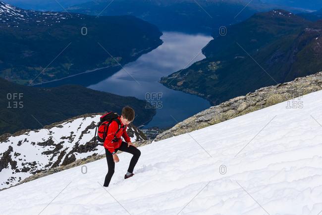 Boy hiking in snowy landscape