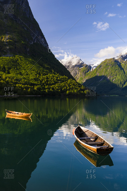 Rowboats on mountain lake - Offset