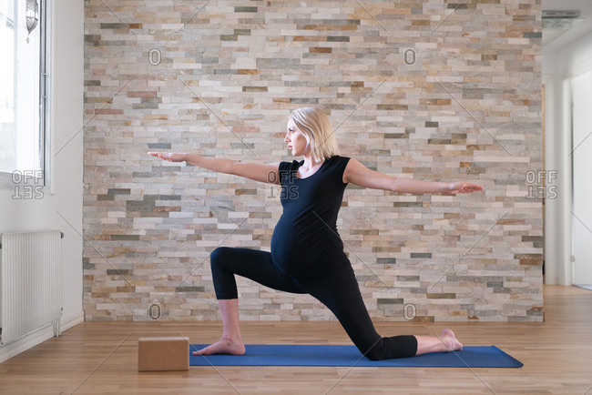 Heavily pregnant woman in yoga position