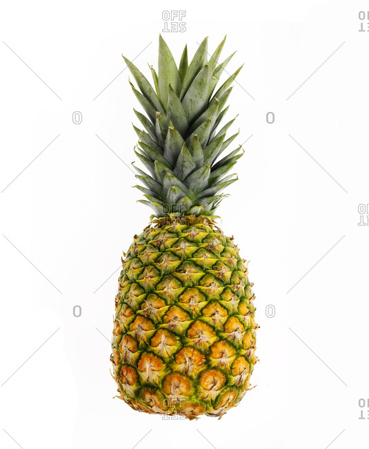 Whole pineapple against white background