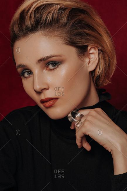 Young blonde woman wears velvet