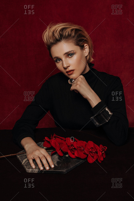 Young blonde woman in velvet with flowers