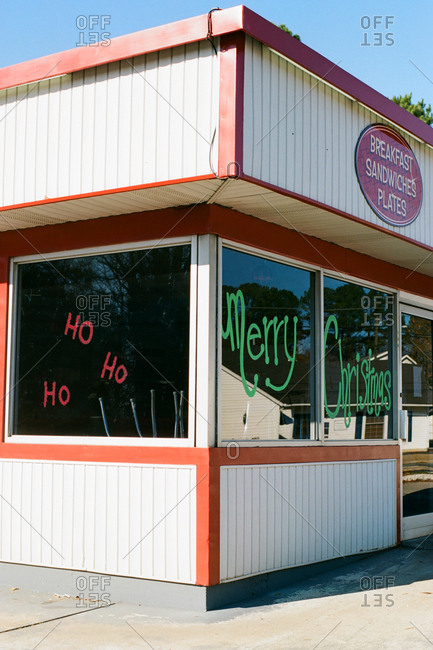 Exterior of diner with Christmas messages on windows