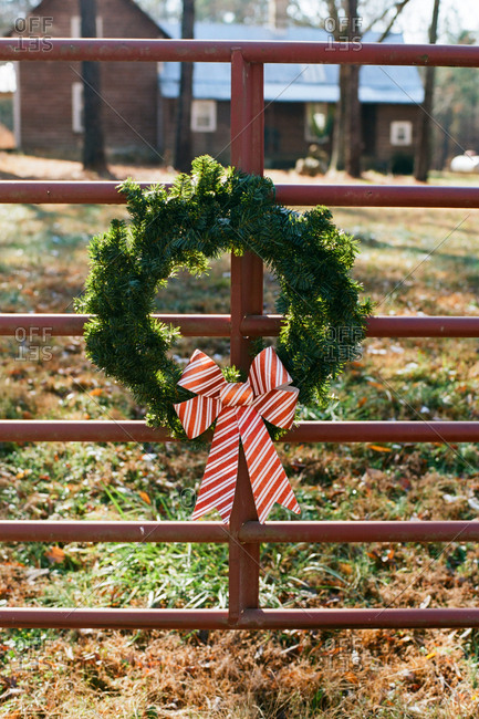 Christmas garland hanging on gate in rural setting