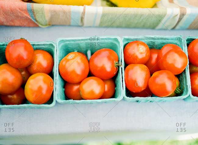 Overhead view of boxes of tomatoes for sale in market