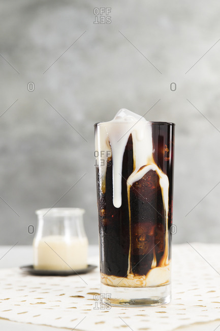 Vietnamese iced coffee with condensed milk dripping on glass