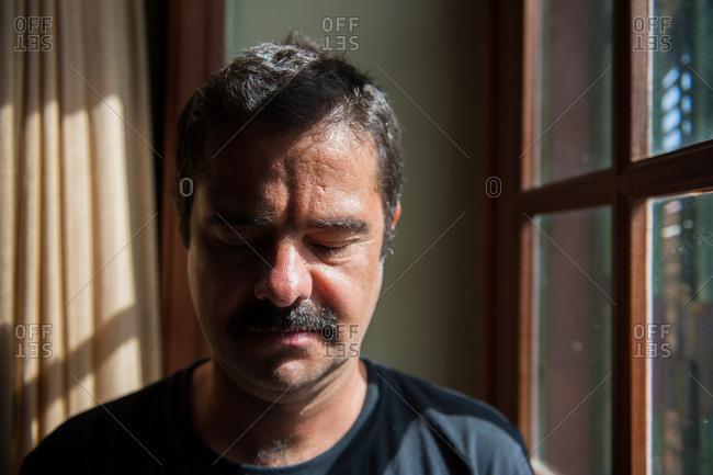 Portrait of meditative man with mustache
