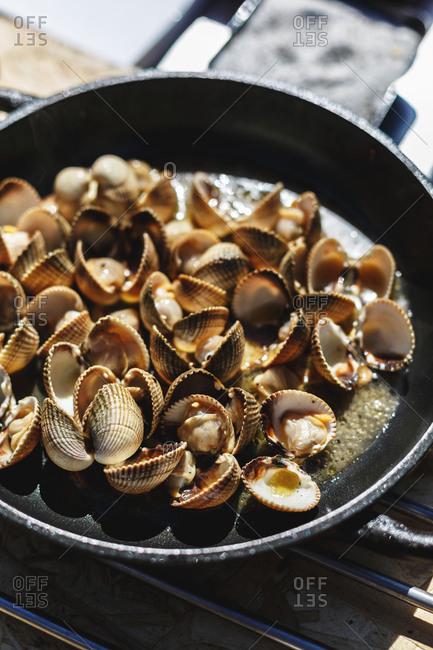 Cast iron skillet of sauteed venus clams