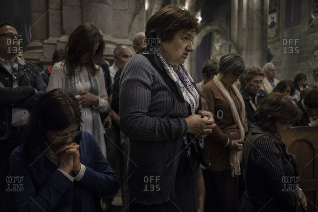 Braga, Portugal - April 13, 2017: People praying during a mass at Braga Cathedral during Holy Week celebrations