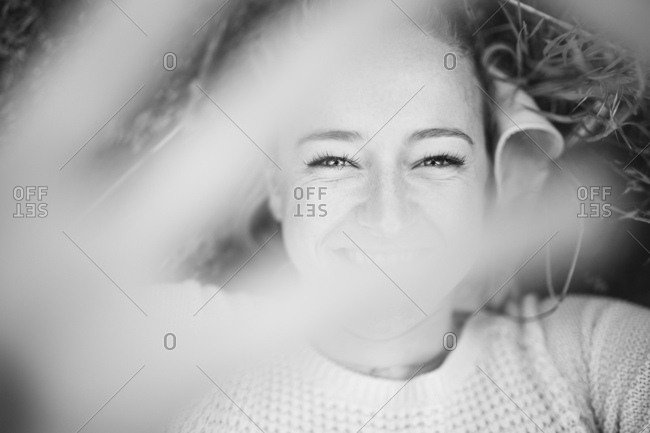 Woman holding hand in front of camera while smiling