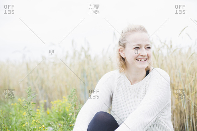 Portrait of a young woman smiling in nature