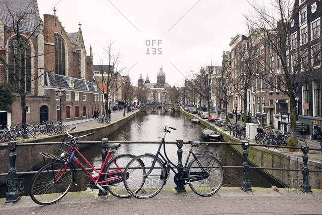 Amsterdam, Holland - February 14, 2018: Bikes parked on bridge in the city of Amsterdam