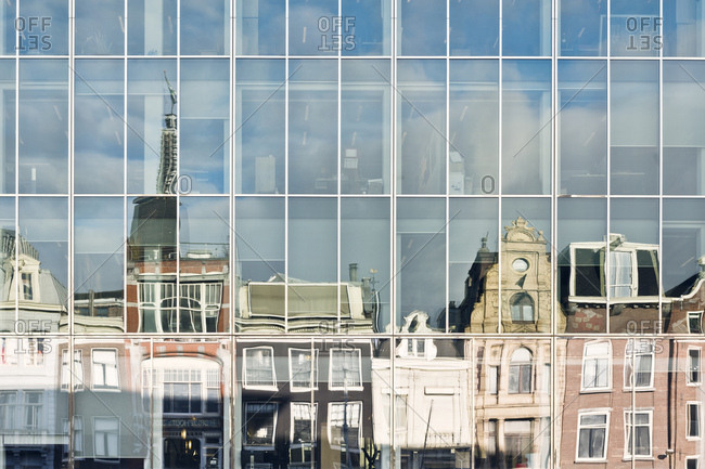 Buildings in Amsterdam reflecting in windows