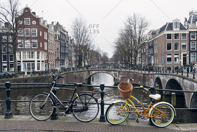 Amsterdam, Holland - February 14, 2018: Bicycles parked on bridge in the city of Amsterdam