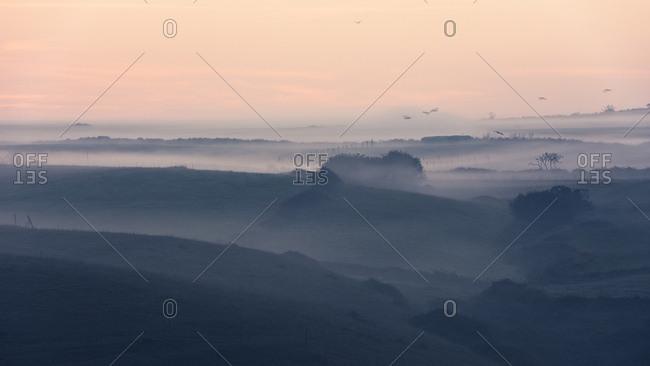 Early morning mist over the backcountry of the coast near Santander, Cantabria, Spain