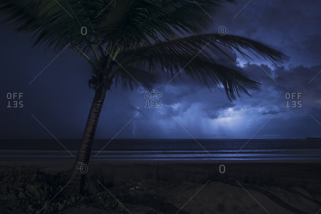 Thunderstorm with lightning over the sea at Coco Beach, Caribbean island Puerto Rico