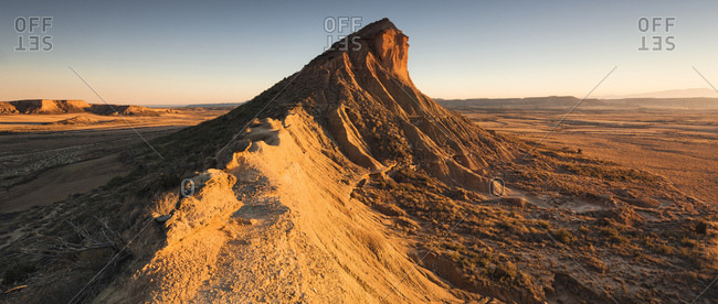 Panoramic view of mountains in the Bardena Reales desert at sunset, Navarra, Spain