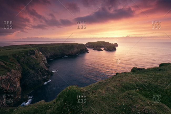Sunset at the cliffs of Benwee Head, County Mayo, Ireland