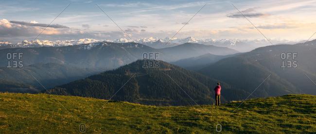 Hiker in front of breathtaking Alpine scenery in the Austrian Alps at Bischofsmytze mountain