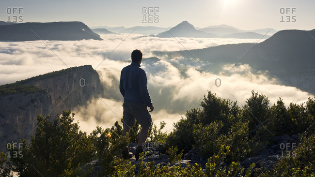 Person in front of the Grand Canyon du Verdon in the French Alps in early morning light