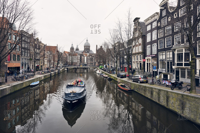 Amsterdam, Holland - February 14, 2018: View of boat in Amsterdam canal