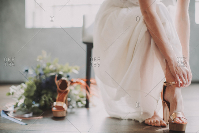 Bride puts on her shoes